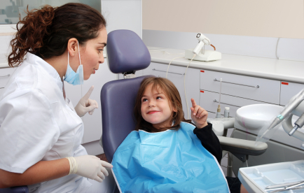 Child smiling after a dental cleaning at Bijan Family Dental Practice